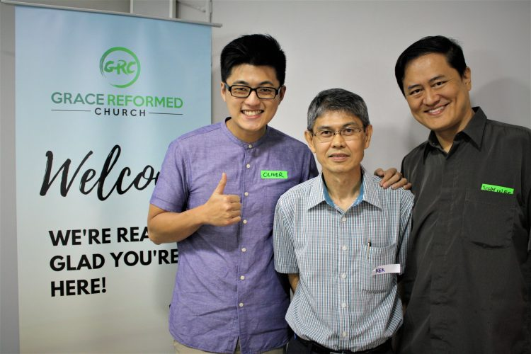 Pastor and guests at Grace Reformed Church